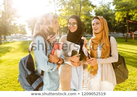счастливым друзей мусульманских женщины ходьбе Сток-фото © deandrobot