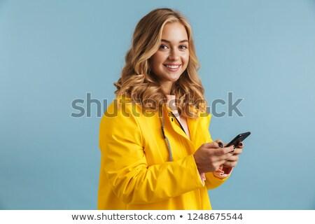 Immagine 20s indossare impermeabile Foto d'archivio © deandrobot