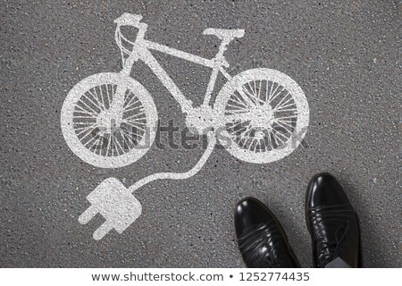 Painted Electric Bicycle On Asphalt Stock photo © AndreyPopov