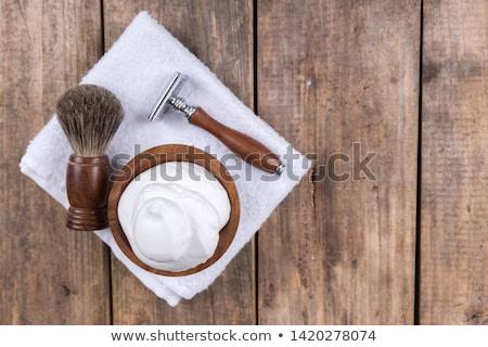 Man shaving with razor in barbershop Stock photo © Kzenon