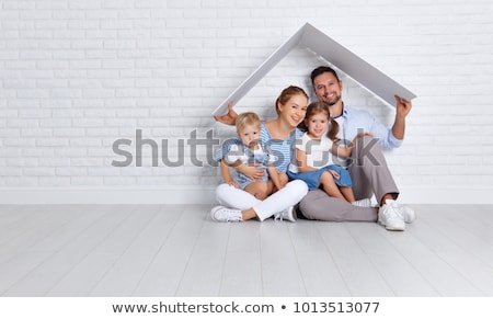 Stock photo: happy family with baby daughter at home