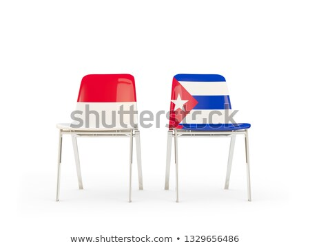 Two chairs with flags of Indonesia and cuba Stock photo © MikhailMishchenko