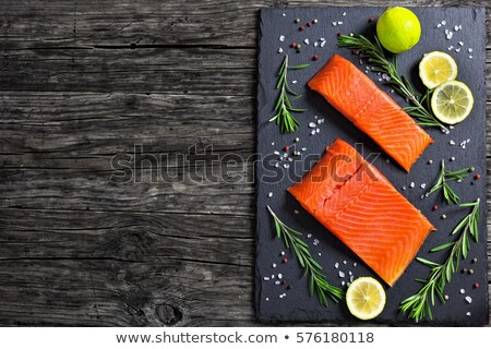 close up of lemon slice on slate table top Stock photo © dolgachov