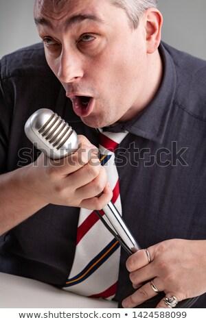 Man muziek microfoon lied Stockfoto © Giulio_Fornasar