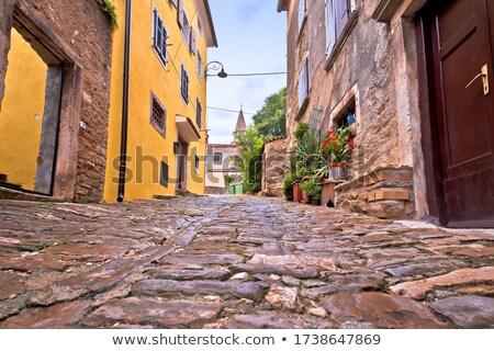 Starych kamień ulicy miasta domu Zdjęcia stock © xbrchx