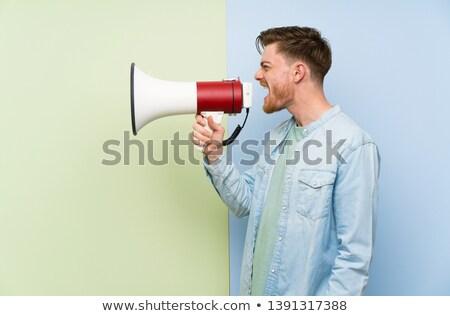 Barba hombre megáfono primer plano gris Foto stock © AndreyPopov