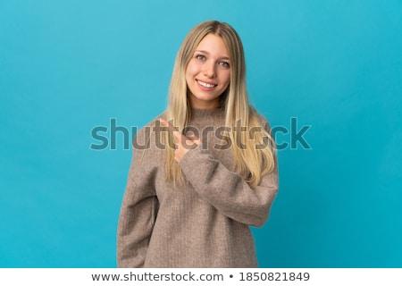 gülen · genç · kadın · işaret · doğru · bakıyor · yalıtılmış - stok fotoğraf © nyul