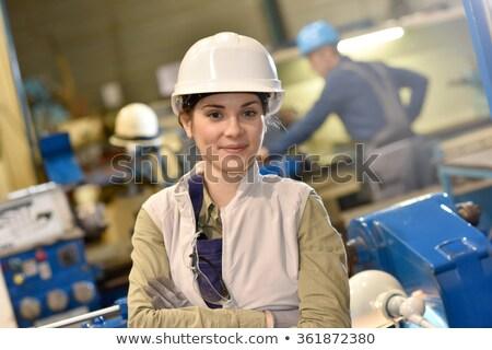 Kobieta pracownika metal warsztaty patrząc kamery Zdjęcia stock © Kzenon