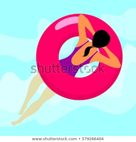 Nő lebeg megnyugtató piros gumi gyűrű Stock fotó © smoki