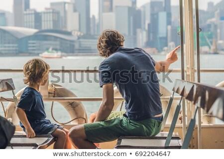 Apa fia úszás komp kikötő égbolt tenger Stock fotó © galitskaya