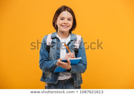 teenage student girl with notebook and pencil Stock photo © dolgachov