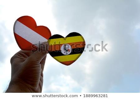 National flag of the Uganda in the shape of a heart and the inscription I love Uganda. Vector illust Stock photo © butenkow