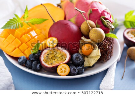 group of sweets as citrus fruits on white plate stock photo © boroda