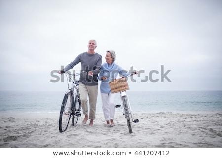 Stockfoto: Paar · strand · fietsen · vrouw · hemel · sport