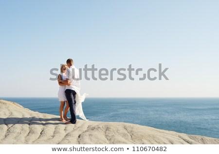 fiatal · pér · beszél · kő · tenger · nő · tengerpart - stock fotó © kotenko