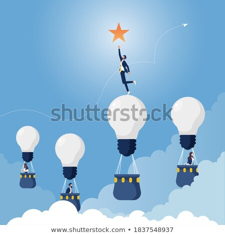 Businessman, reaching in to the air Stock photo © photography33
