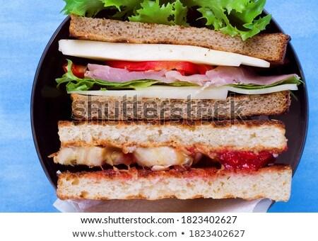two jam and lettuce sandwhiches Stock photo © Antonio-S