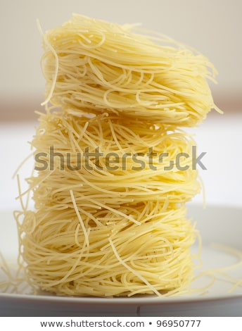 Nests of Raw Vermicelli Stock photo © zhekos