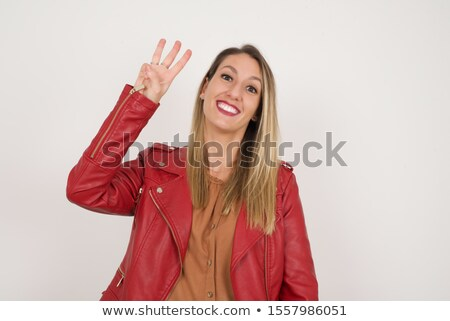 three casual women in leather jackets looking up stock photo © feedough