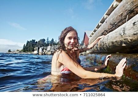 tinilány · úszik · tó · tinilány · csobbanás · dokk - stock fotó © is2