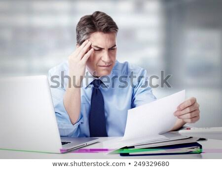 Zdenerwowany człowiek biznesu problemy pracy posiedzenia tabeli Zdjęcia stock © deandrobot
