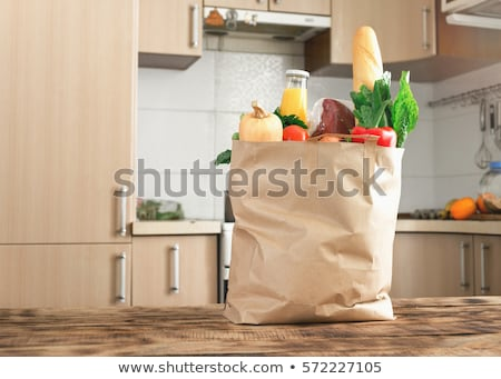 close up of paper bag with vegetable food Stock photo © dolgachov