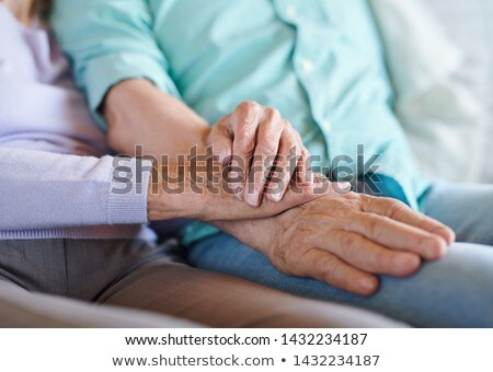 Senior spouses in casualwear holding by hands Stock photo © pressmaster