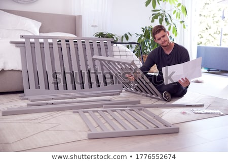 Man Reading Assembly Instructions For Flat Pack Furniture Stock photo © monkey_business
