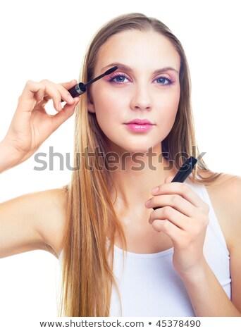 Pretty woman with long blond hair applying black mascara on eyelashes Stock photo © pressmaster