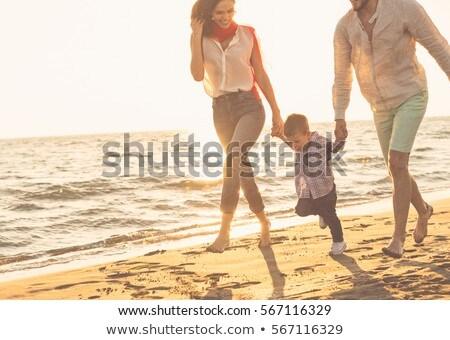 Boldog fiatal család jókedv tengerpart élet Stock fotó © dotshock