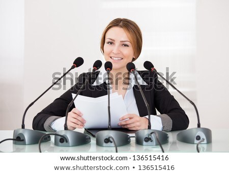Politikus nő sajtótájékoztató gyönyörű fiatal felnőtt sajtó Stock fotó © Kakigori