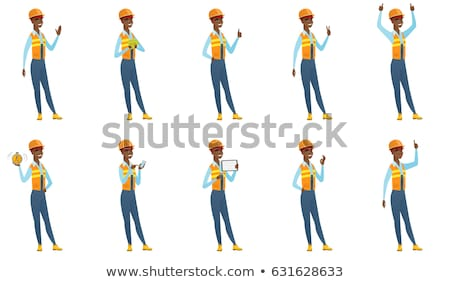 A victorious female construction worker. Stock photo © photography33