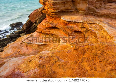 Red Waves on a Red Sandstone Beach Stock photo © wildnerdpix