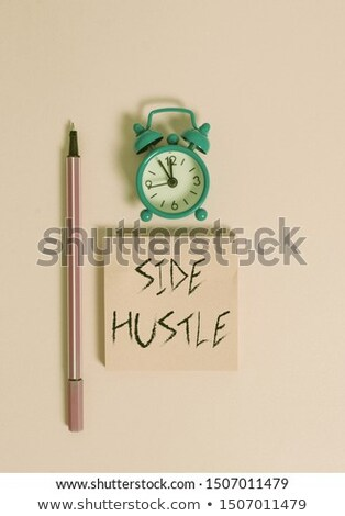 Laborer holding bills and alarm clock Stock photo © photography33