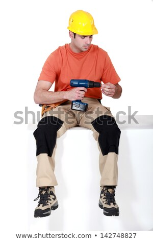 Man sat holding cordless drill Stock photo © photography33
