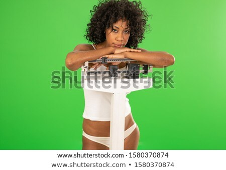 Posing woman in underwear on a scale in a studio Stock photo © wavebreak_media
