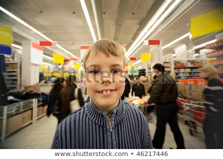 Smilling boy stand in centre of trading floor in supermarket Stock photo © Paha_L