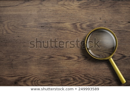 Loupe magnifying glass on wooden desk, top view Stock photo © stevanovicigor