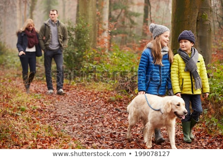 Boy and girl walking through forest Stock photo © IS2