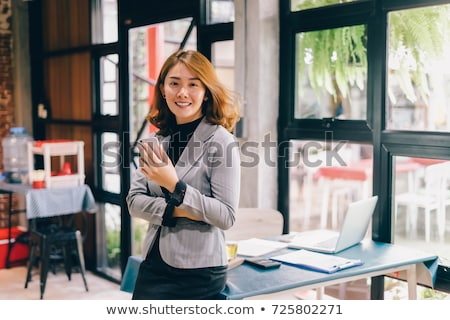 asian woman student with tablet pc at home stock photo © dolgachov