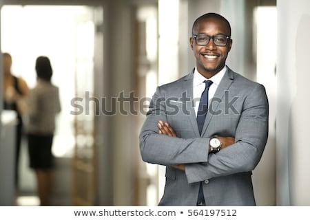 Portret glimlachend zakenman zwart pak permanente licht Stockfoto © feedough