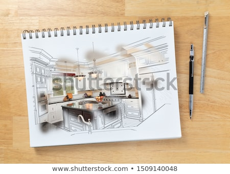 Sketch Pad on Desk with Drawing of Kitchen and Brush Stroke Show Stock photo © feverpitch