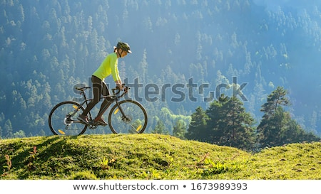 esportes · bicicleta · mulher · prado · belo · paisagem - foto stock © ra2studio