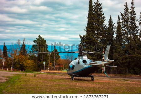 Helicopter flying in the sky among the clouds Stock photo © galitskaya