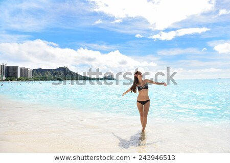 Happy Asian bikini woman enjoying holidays on Waikiki beach in Honolulu city, Oahu, with diamond hea Stock photo © Maridav