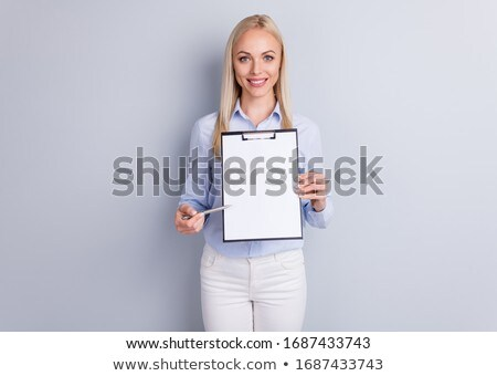 Young woman holding and pointing to a blank sign Stock photo © photography33
