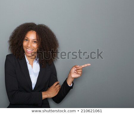 african businesswoman pointing finger up stock photo © deandrobot