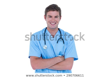 Young nurse in blue tunic with arms crossed Stock photo © wavebreak_media