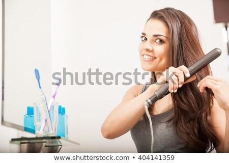 Pretty brunette getting her hair styled Stock photo © wavebreak_media