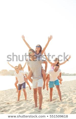 Uśmiechnięty chłopak sympatia stałego plaży kobieta Zdjęcia stock © wavebreak_media